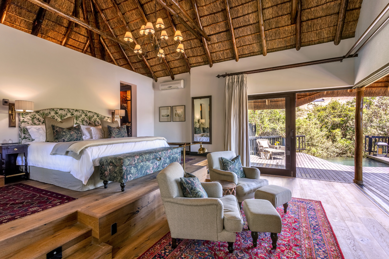 Lalibela Game Reserve - Kichaka Lodge - Bedroom 1 - Bed & Lounge Area looking onto Private Viewing Deck